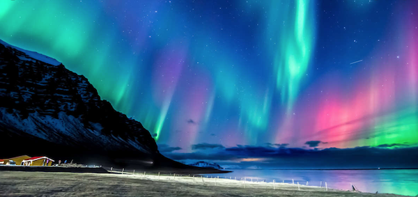 Empty beach and aurora borealis