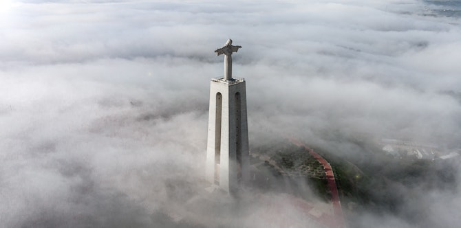 Jesus statue on top of a building
